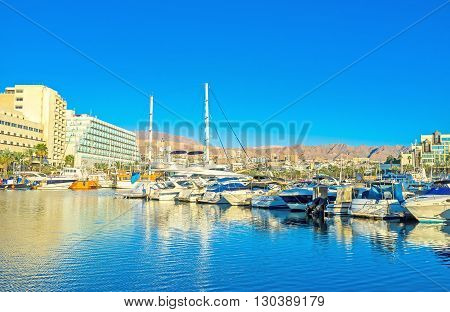 EILAT ISRAEL - FEBRUARY 23 2016: The resort is popular among the tourists and travelers all over the world so here are a lot of yachts from different countries on February 23 in Eilat.