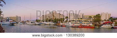 EILAT ISRAEL - FEBRUARY 23 2016: The view from the bridge on the wide marina and the tourist neighborhood located around it on February 23 in Eilat.