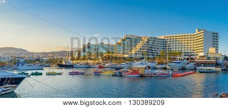 The sunset beams and various colorful boats and yachts make Lagoona of Eilat one of the most beautiful locations in resort Israel.