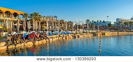 EILAT ISRAEL - FEBRUARY 24 2016: The morning common prayer during the sunrise at the North beach on February 24 in Eilat.