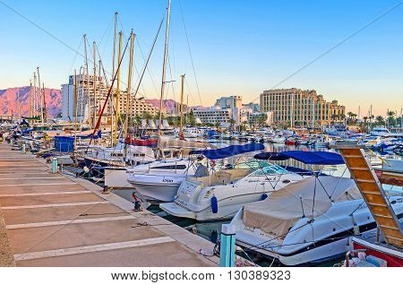 EILAT ISRAEL - FEBRUARY 23 2016: The marina located in the center of resort is one of the most tourist places on February 23 in Eilat.