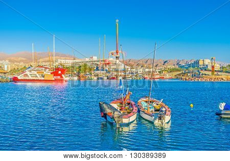 EILAT ISRAEL - FEBRUARY 23 2016: The city center with amusement park harbor and the rocky mountains on the background on February 23 in Eilat.