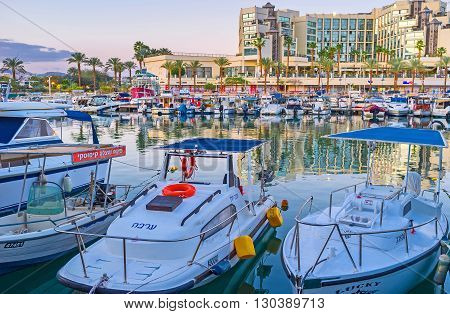 EILAT ISRAEL - FEBRUARY 23 2016: There are a lot of different motor boats in port on February 23 in Eilat.