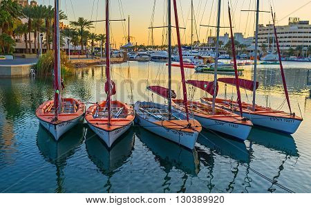 EILAT ISRAEL - FEBRUARY 23 2016: The small sailing yachts are dancing on the waves in Lagoona on February 23 in Eilat.