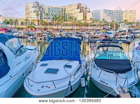 EILAT ISRAEL - FEBRUARY 23 2016: The lines of white motor boats in port are ready for the trips and fishing tours on February 23 in Eilat.