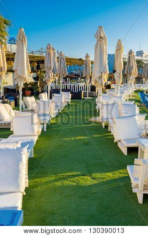 EILAT ISRAEL - FEBRUARY 24 2016: The white benches with the fluffy pillows for the best relax on central beach on February 24 in Eilat.