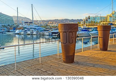 EILAT ISRAEL - FEBRUARY 23 2016: The promenade of Lagoona decorated with the large flower pots on February 23 in Eilat.