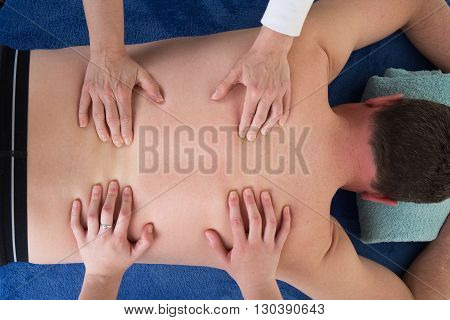 Thai Back Massage With Four Hands On The Back Of The Man