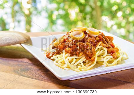 Close up spaghetti with tomato sauce and sausage