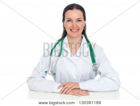 Beautiful Smiling Female Doctor Sitting At The Desk. Isolated