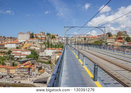 PORTO, PORTUGAL - APRIL 20, 2016: Tracks on top of the Ponte Luis I in Porto, Portugal