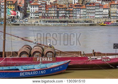 PORTO, PORTUGAL - APRIL 21, 2016: Port with wine barrels on a ship in Porto, Portugal