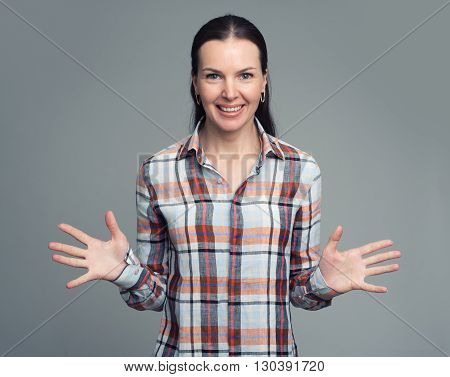 Young Beautiful Woman In Plaid Shirt Smiling