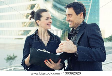 Two Business Collegues Talking And Laughing