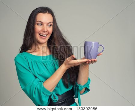Beautiful Woman Showing A Mug