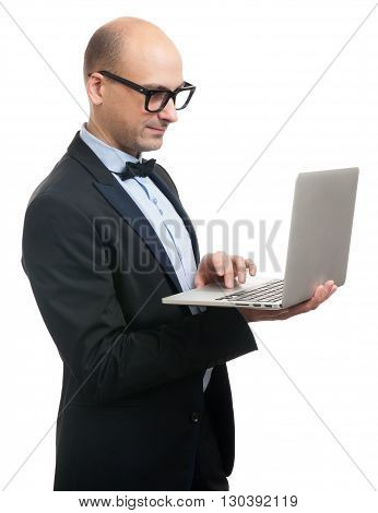 Bald Stylish Man In Suit And Glasses With Laptop.