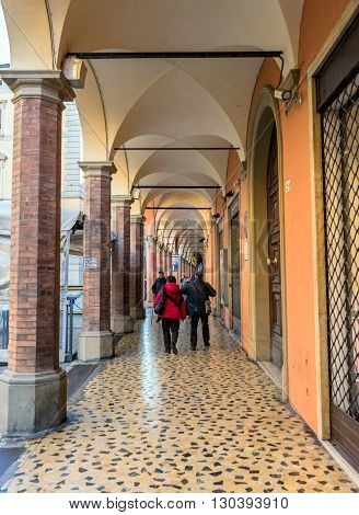 Bologna Italy - December 27 2015: day view of Bologna's passage way. In total there are about 38 kilometres of arcades in the city's historical centre In Bologna Italy.