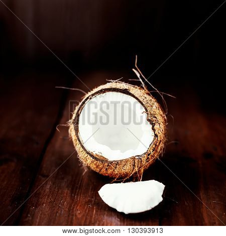 Coconut fruit / close up of a coconut on a wooden background with copy space