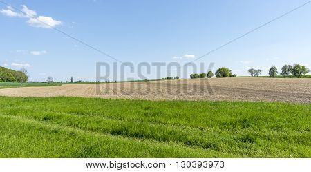 sunny agricultural scenery at a plowed field in Hohenlohe a district in Southern Germany
