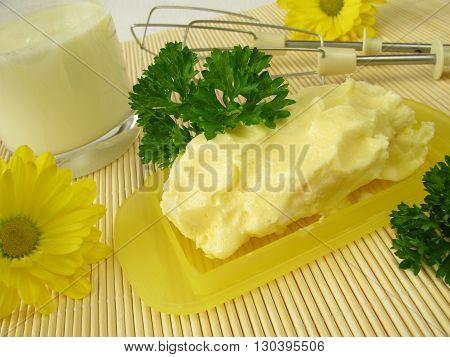 Fresh homemade butter and glass of buttermilk