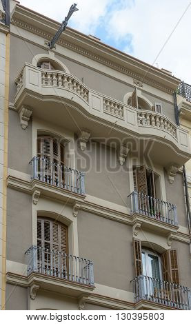 BARCELONA, SPAIN - JUNE 16: Scattered light of cloudy summer day is illuminating facade of building on Rossello Carrer del Street, 273 on June 16, 2014 in Barcelona, Spain.
