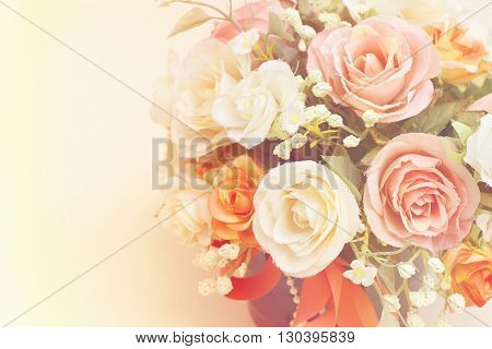 Beautiful artificial flowers with copy space in composition.