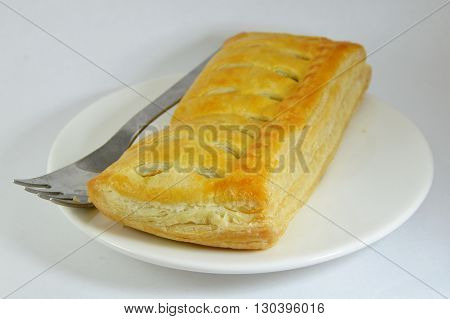 chicken curry filled pie and fork on dish