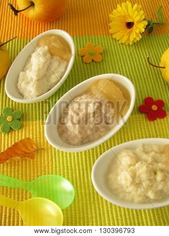Small bowls with millet porridge, creamed rice and spelt mash for babies and children