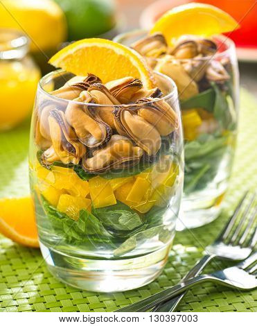 A delicious layered mussel salad with citrus vinaigrette.