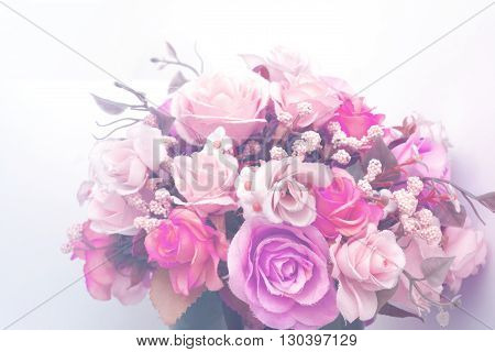 Beautiful artificial flowers with vintage style effect fill in photo.