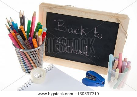 Back To School Supplies. Note Pad And Blackboard.