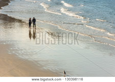 Happy Romantic Couple Walking On The Atlantic Beach