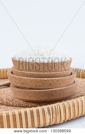 Raw and uncooked rice in basket weave,shallow Depth of Field,Focus on rice.