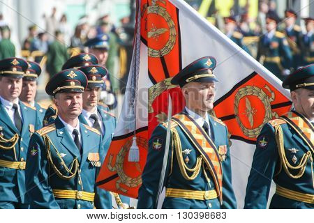 St. Petersburg, Russia - 9 May, Officers with the flag in the parade, 9 May, 2016. Festive military parade on the Palace Square in St. Petersburg.