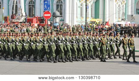 St. Petersburg, Russia - 9 May, Soldiers with Kalashnikovs in the ranks, 9 May, 2016. Festive military parade on the Palace Square in St. Petersburg.