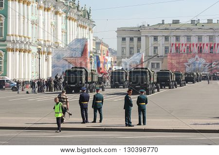 St. Petersburg, Russia - 9 May, Division multifunctional military trucks on the Victory Parade, 9 May, 2016. Festive military parade on the Palace Square in St. Petersburg.