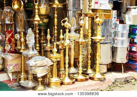 Shop selling gilded stands. South India. Gold-plated stands