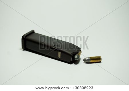 9 mm ammunition magazine isolated on white background