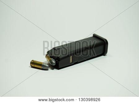 9 mm ammunition magazine on white background