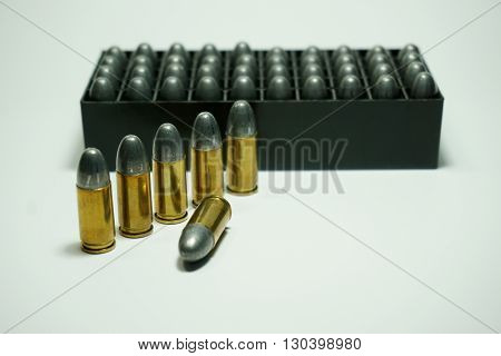 9mm bullets wit box isolated on white background