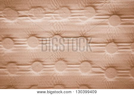Marks of bottles pressing down on to cardboard texture background vintage effect