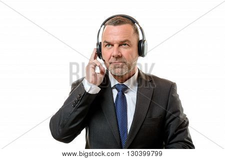 Businessman Listening Carefully On Headphones