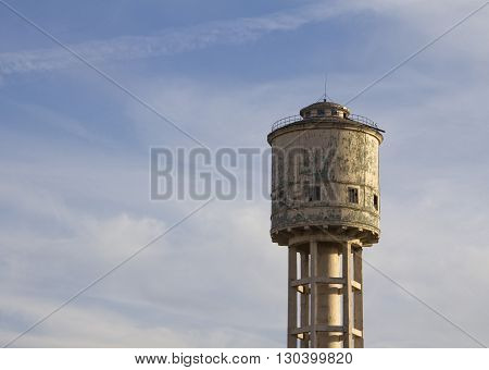 Old Water tower against the blue sky