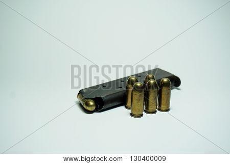 11 mm pistol ammunition on white background