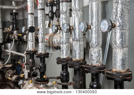Industrial boiler interior with pipes and valves
