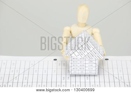 Wooden Dummy Holding House With White Background