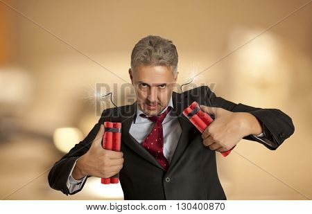 Crazy businessman holding explosive bomb.  Concept business competition