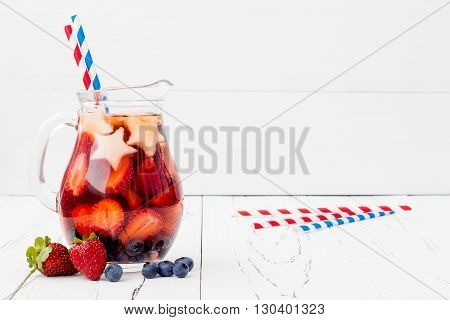 Red White and Blue Lemonade or Sangria. Patriotic drink cocktail with strawberry blueberry and apple for 4th of July party