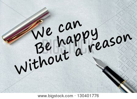Text We can be happy without a reason on silver napkin