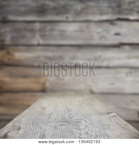 Blurred wooden background. Thin strip of focus in the foreground
